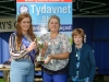 Tydavnet Show Queen Shauna McAree, left and President of Tydavnet Show, Mary Sherry, right, presenting Eleanor O'Neill with the Country Markets Cup for Jam & Chutney. ©Rory Geary/The Northern Standard