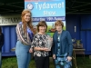 Tydavnet Show Queen Shauna McAree, left and President of Tydavnet Show, Mary Sherry, right, presenting Dympna McKenna, centre, with the Magill Vase for Rose of the Show. ©Rory Geary/The Northern Standard