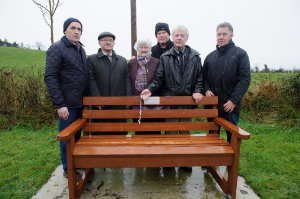 At the unveiling of a bench in memory of Benny McKenna, who started the Christmas Day Swim at Emy Lake, was Benny's wife Veronica and son Conleith, with members o fthe Donagh Development Association, who had the bench placed at the lake. In photo are (L-R) John Sherry, Seamus McAree, Veronica and Conleith McKenna, Pat McKenna and Aidan McKenna. ©Rory Geary/The Northern Standard