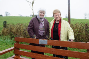 Veronica McKenna, left, the wife of the Late Benny McKenna, who organised the first Christmas Day Swim at Emy Lake for the Emyvale Scout Unit, with Nancy McCluskey, at this years swim, when the bench in memory of Benny was unveiled. ©Rory Geary/The Northern Standard