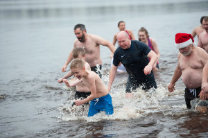Some of the group in the water at Emy Lake during the Christmas Day Swim. ©Rory Geary/The Northern Standard