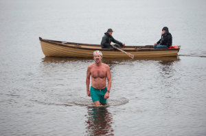 Mark Leslie as he finished his swim on Christmas Day at Emy Lake. ©Rory Geary/The Northern Standard