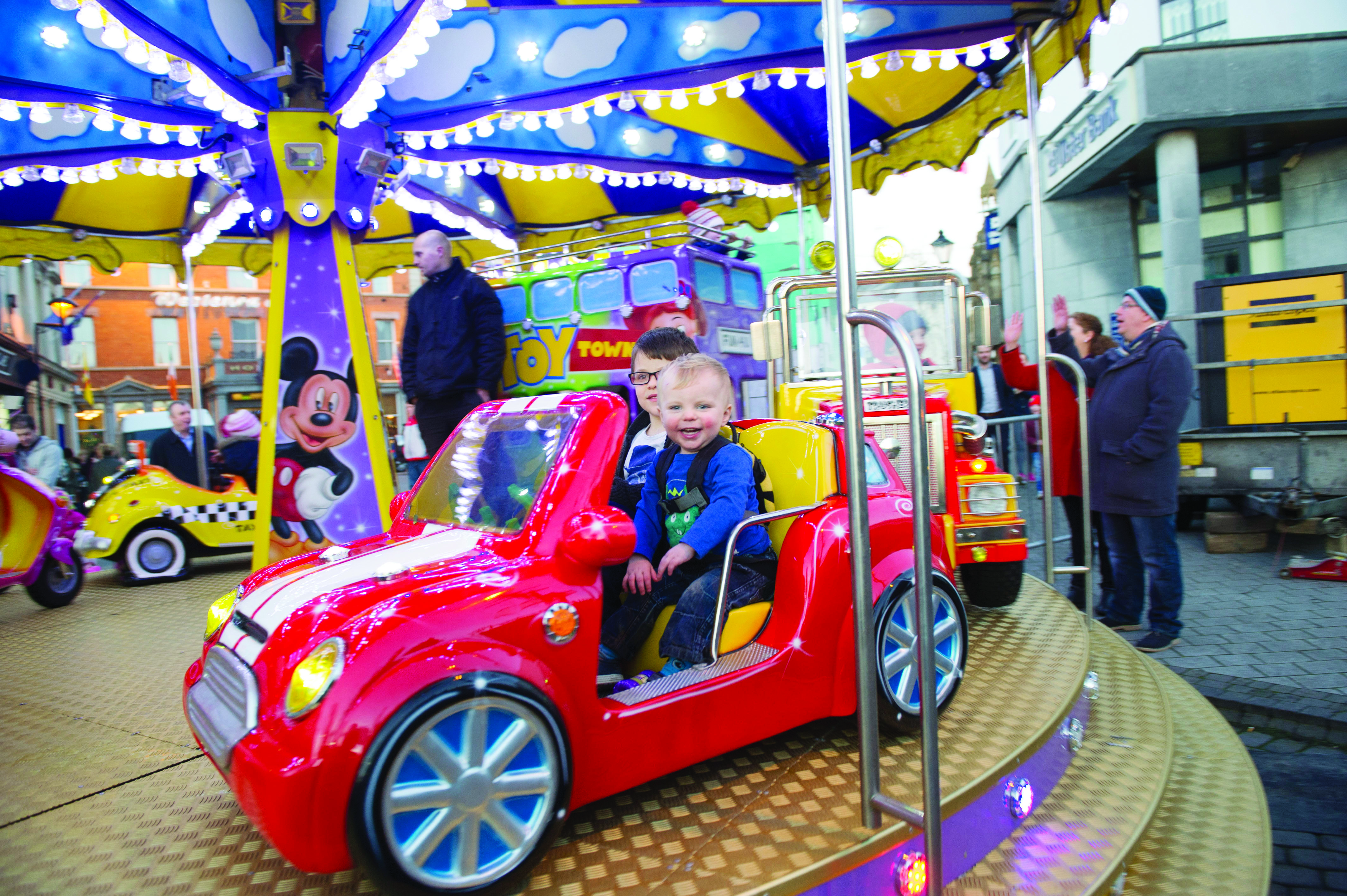 Some of the children enjoying a fairground carousel at the Monaghan Town Christmas Lights Switch-On. ©Rory Geary/The Northern Standard
