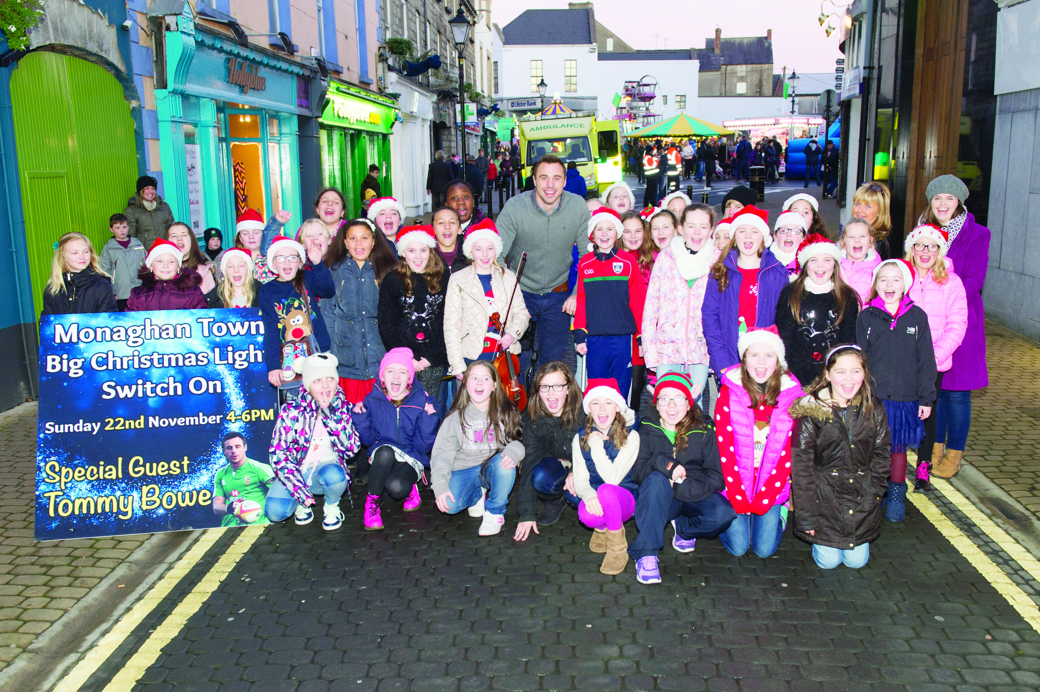 Tommy Bowe with the St Louis Girls School Choir at the Monaghan Town Christmas Lights Switch-On. ©Rory Geary/The Northern Standard