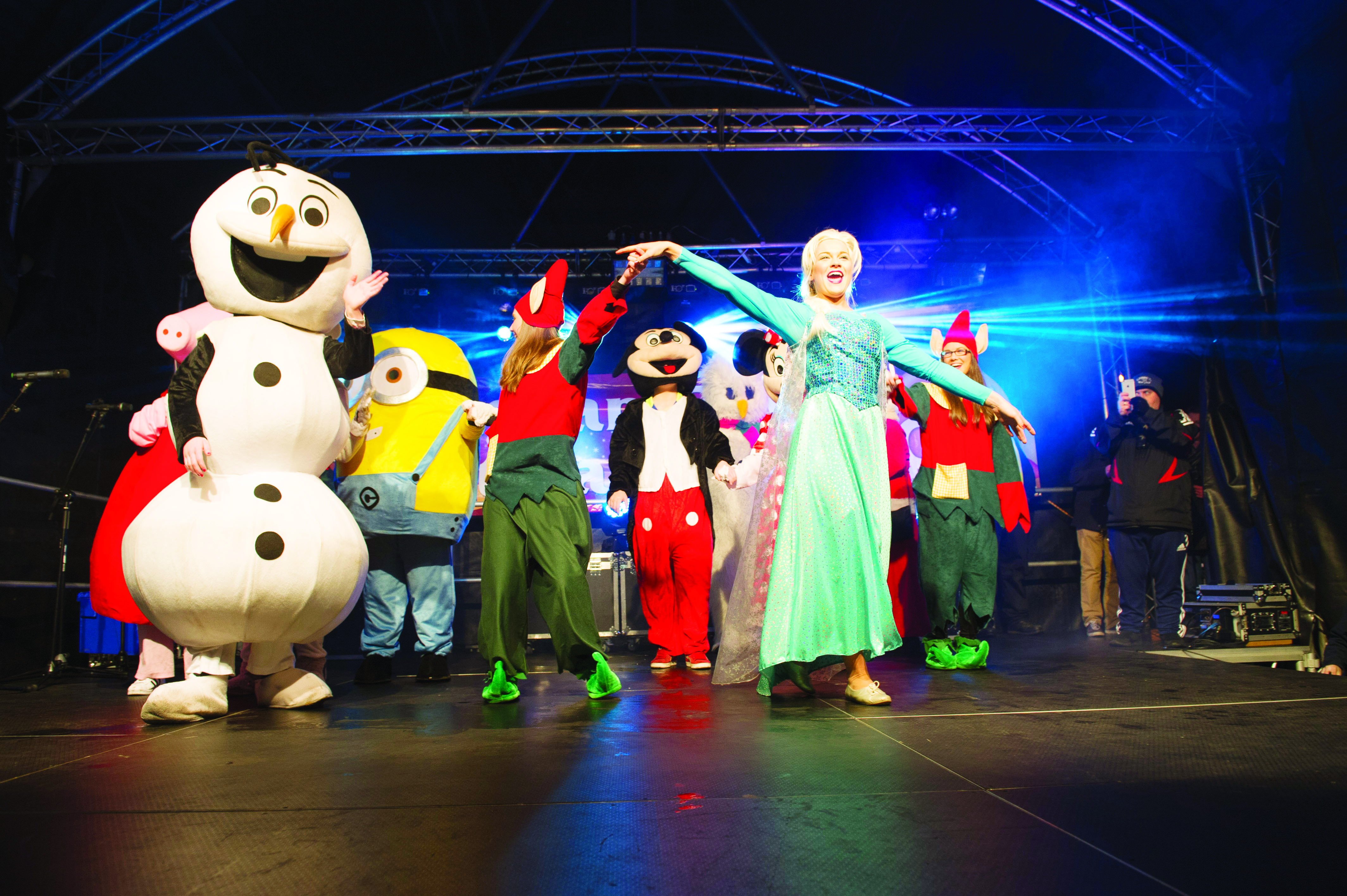 Elsa from Frozen and some of the other characters who attended the Monaghan Town Christmas Lights Switch-On, singing on stage at the event. ©Rory Geary/The Northern Standard