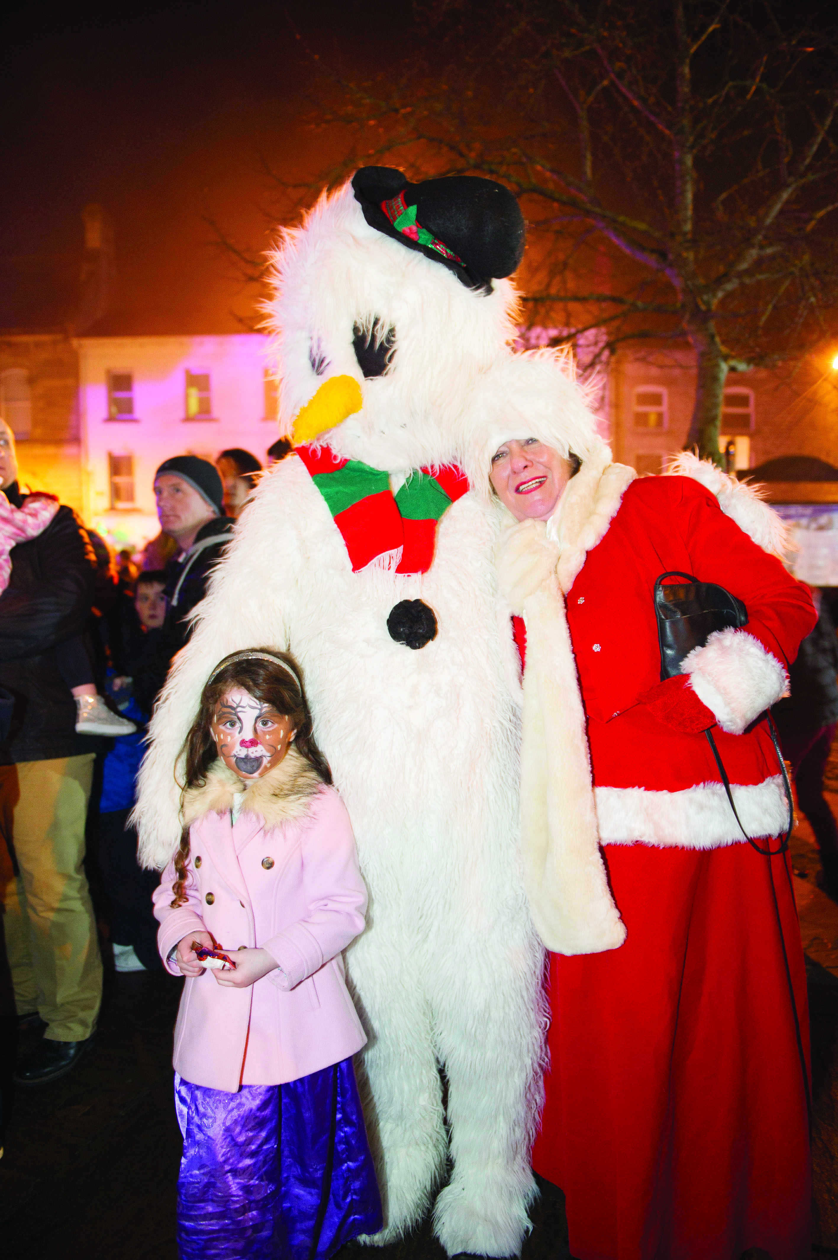 Frosty and Mrs Claus with one of the attendance at the Monaghan Town Christmas Lights Switch-On. ©Rory Geary/The Northern Standard