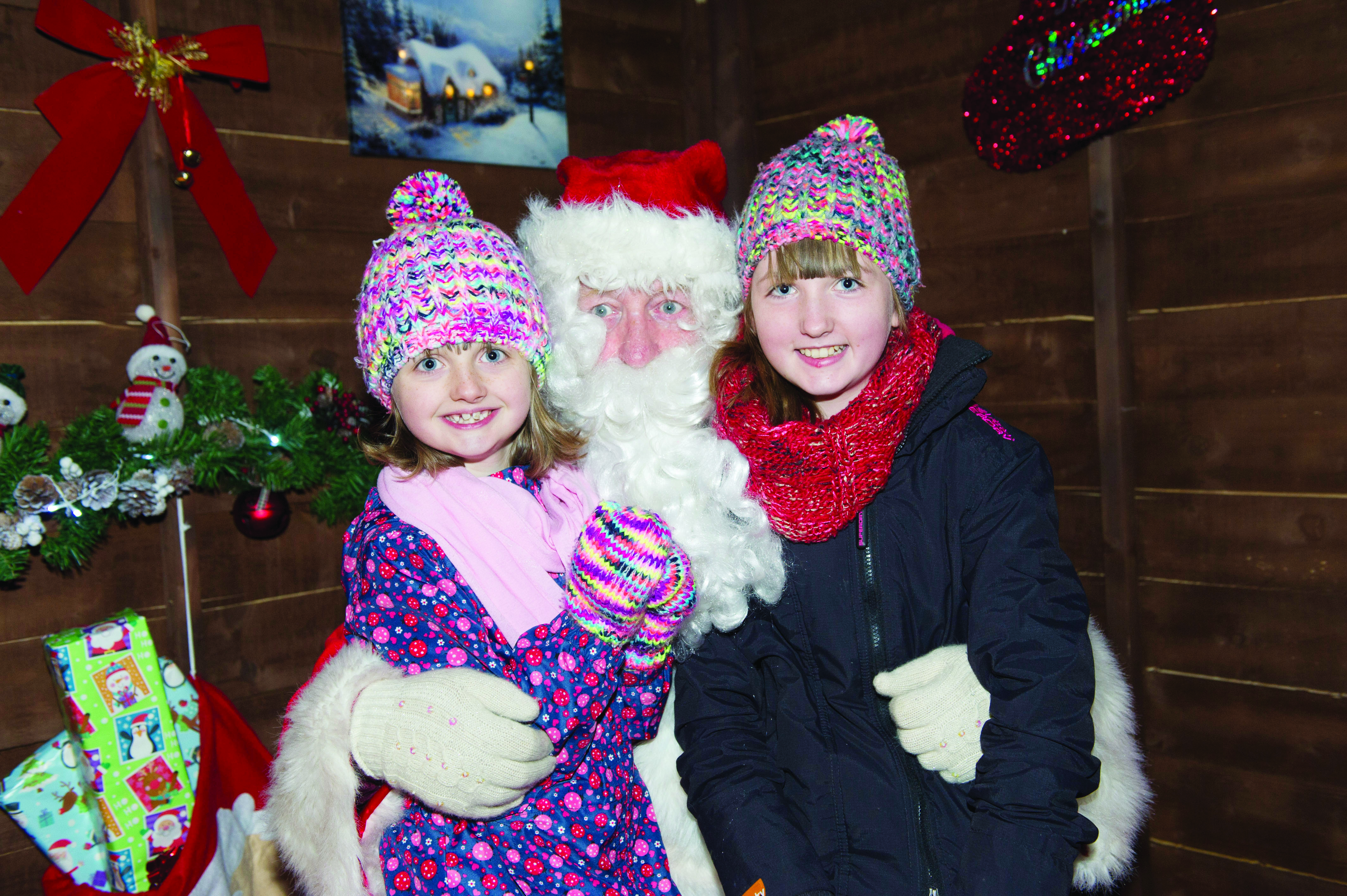 Santa with 2 young girls at the Monaghan Town Christmas Lights Switch-On. ©Rory Geary/The Northern Standard