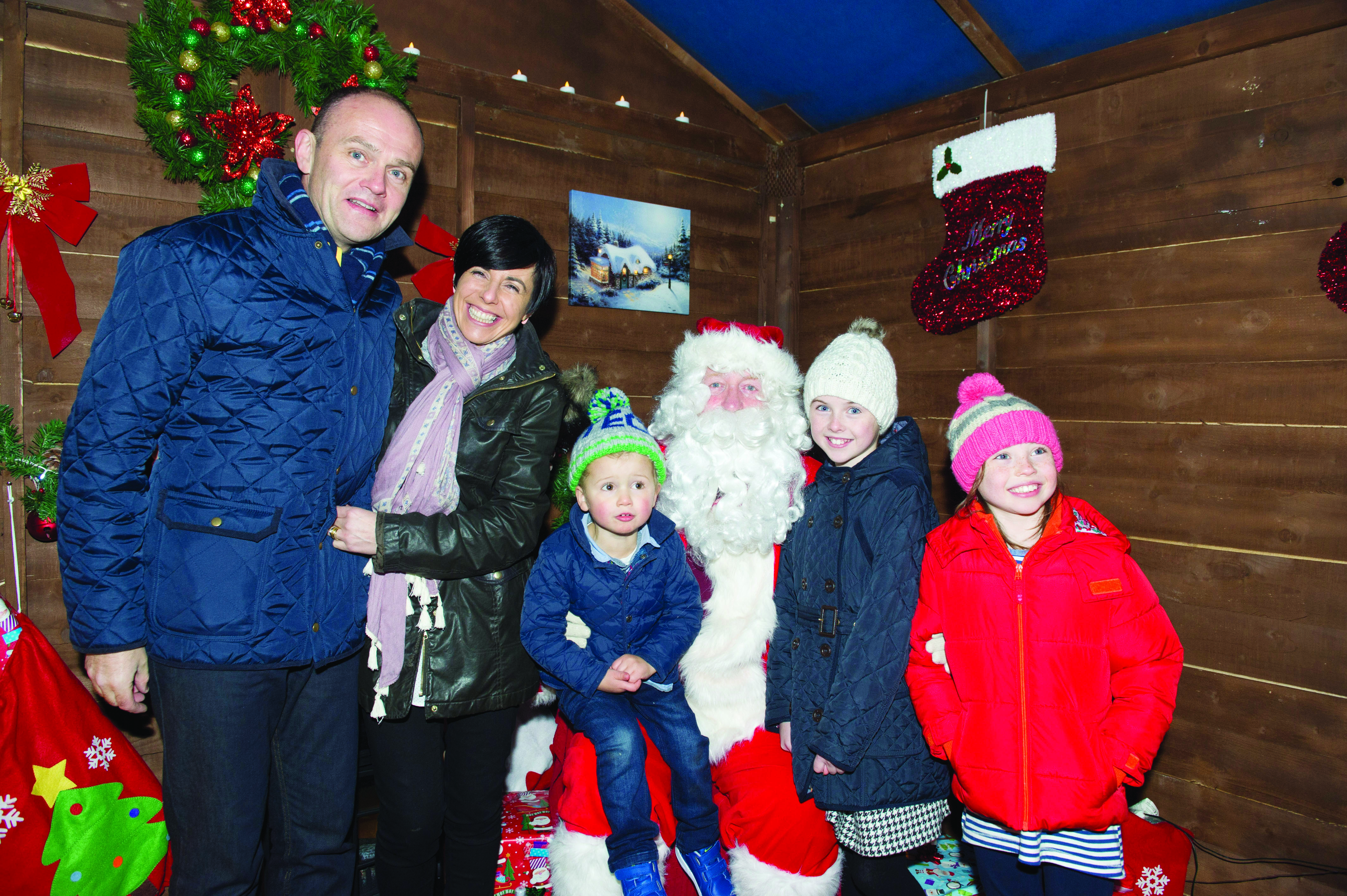 Santa with members of the Kellett family that met him at the Monaghan Town Christmas Lights Switch-On. ©Rory Geary/The Northern Standard